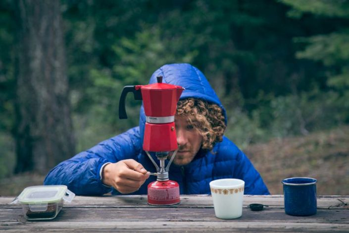 Making coffee with a Pantone percolator while camping.
